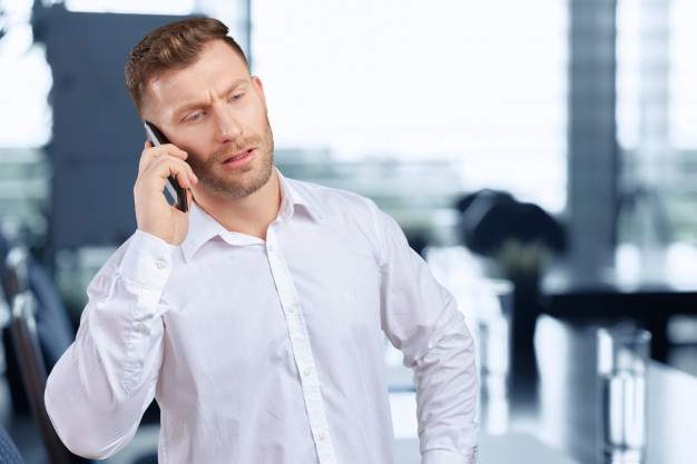 a salesman convincing customer on the phone